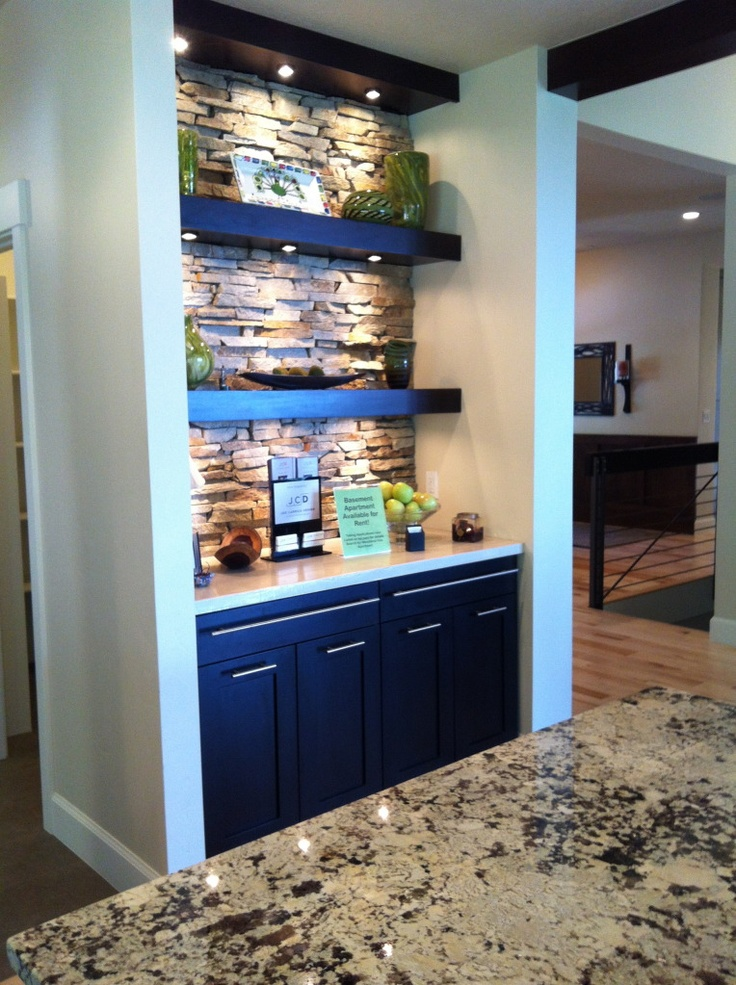 beautiful display area in kitchen w/ stone wall, beautiful lit shelves & modern cabinets (uvparade 2012)