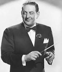 """Guy Lombardo, 1902 - 1977. 75; violinist,  bandleader. From the 30's through the 70's. Best known for hosting New Years Eve celebrations on TV and conducting the song, """"Auld Lang Syne."""