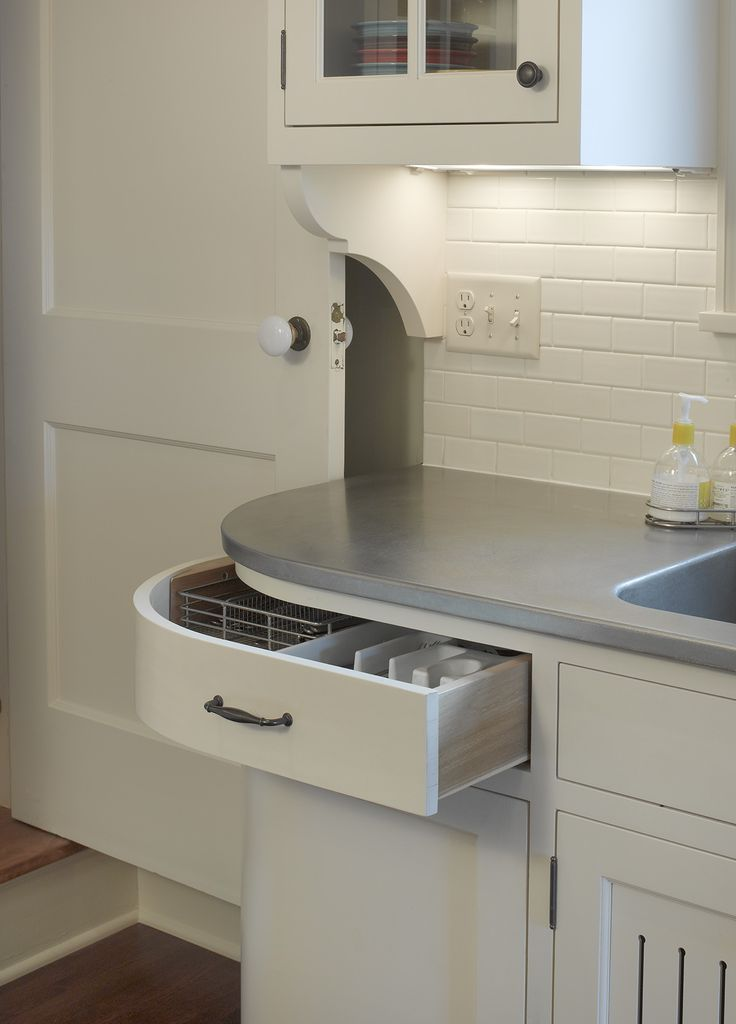 In This Kitchen A Curved Drawer And Base Cabinet
