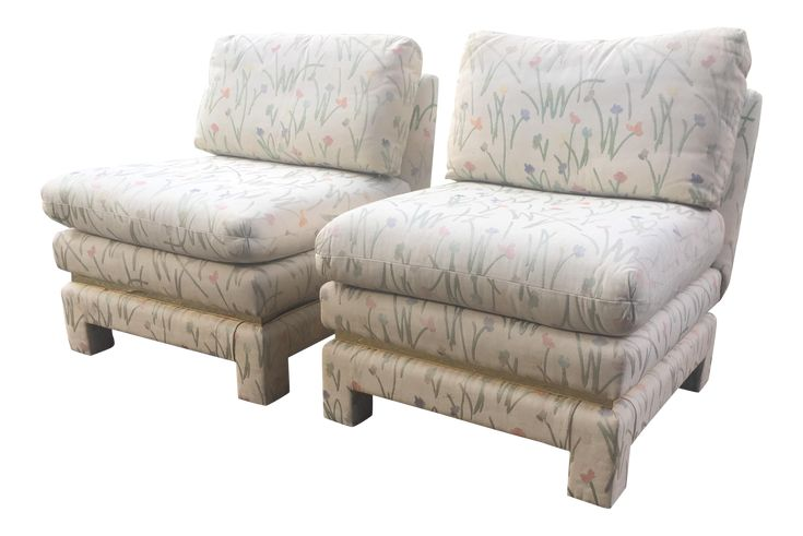 """A pair of vintage armless slipper chairs with gold tone metal trim at the base. Fully upholstered with large removable seat and rear cushions. Fantastic look for many styles - Hollywood Regency, Mid-Century, Modern, Contemporary and more. Heavy, solid well-made chairs that need reupholstering. Fabric is faded and chairs were in a smokers house at one point.   Additional measurement: Seat height 18"""""""