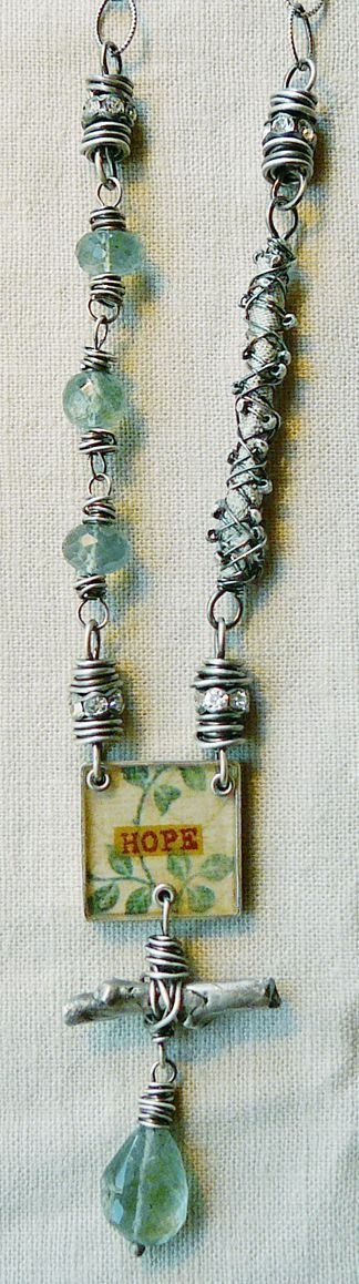 Nina Bagley, artist.  Note the wire and rhinestone rondelle beads, handmade.  Nice addition to a style.