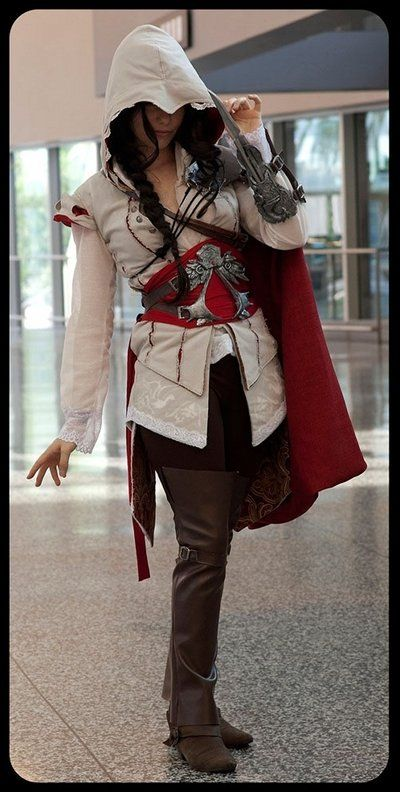 Female cosplay of Ezio (Assassin's Creed 2). Surprisingly and thankfully, it's not one of those sexy variations of his outfit. Assassins gotta stay properly and stylishly clothed!