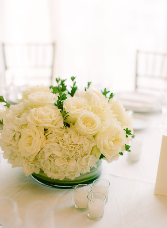 Love the texture, maybe with some color. Green hydrangea or coral roses?  Loving this idea for some low centerpieces