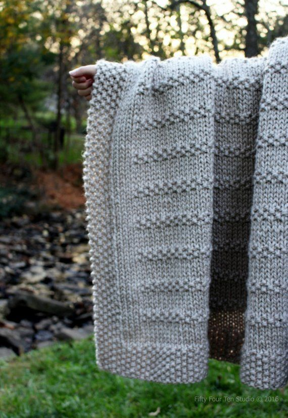 58aa4f8393b6a Stones in the Road blanket knitting pattern by Fifty Four Ten Studio. Easy  to knit with super bulky yarn. Instructions for 6 blanket sizes  baby