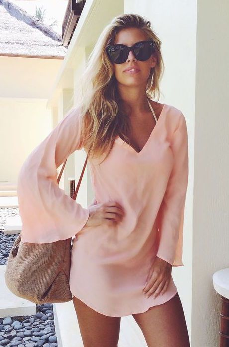 Light pink shirt dress with bell sleeves.