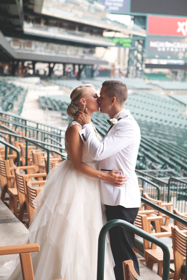 Erin & Kyle on their wedding day | Erin is wearing Carrie by Hayley Paige available at Pearl Bridal House. Photo by Clarissa Marie Photography. View this couple's Love Story on our website
