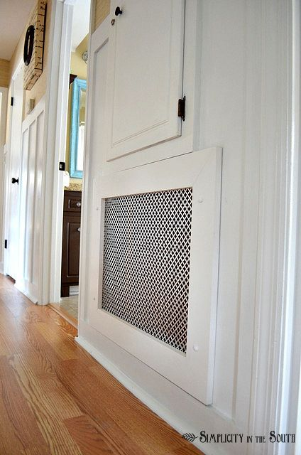 DIY air return vent cover...love the paneling in this room. Would work in living room...
