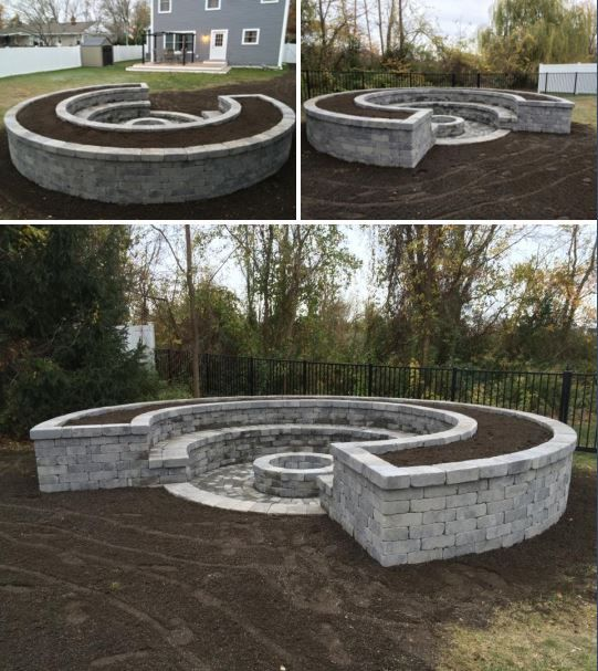 Custom fire pit with bench seating and raised planter surround.