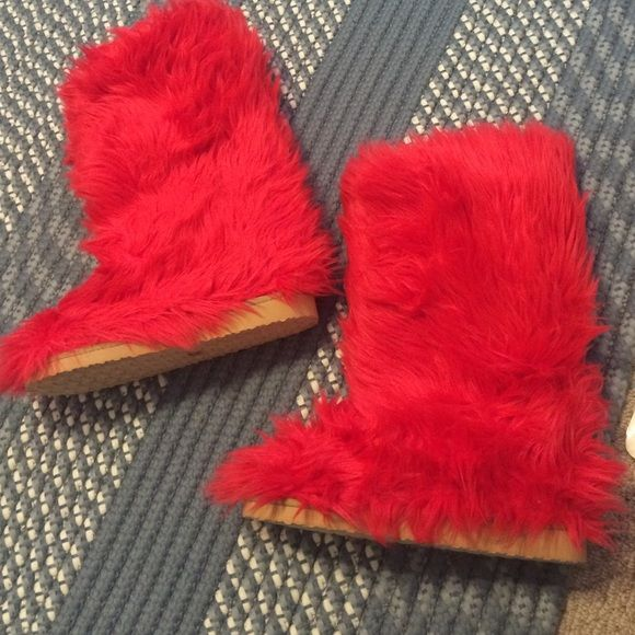 Red furry boots ♥️ Fluffy wuffy boots size 7 (other than the picture posted I have never worn these boots out before, the soles are brand new 😊) Fluffy Wuffy Shoes