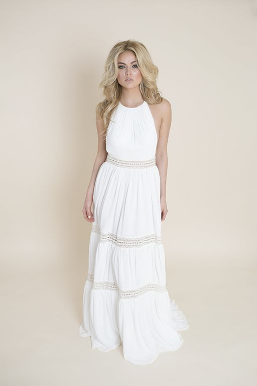 Cameron Darling II This alluring halter wedding dress features a slightly pleated bodice that  finishes at the natural waist. The skirt consists of 3 tiers of flowing chiffon with each layer finishing with a see-through embroidery ribbon. The back features a T-back constructed of embroidery ribbon detail and a very low scoop back. This is perfect for a beach wedding!