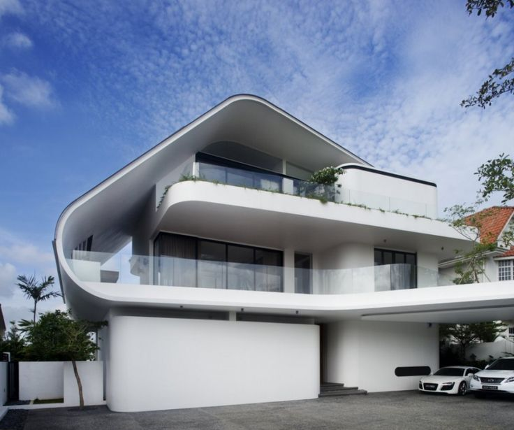 Exterior house designs ideas with unique shape level floors and white wall color also combine with glass windows and glass barrier also fences and carport