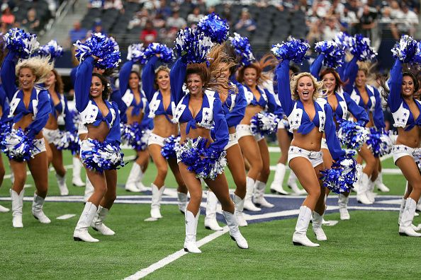 ARLINGTON, TX - SEPTEMBER 11: Dallas Cowboys cheerleaders perform on the field…