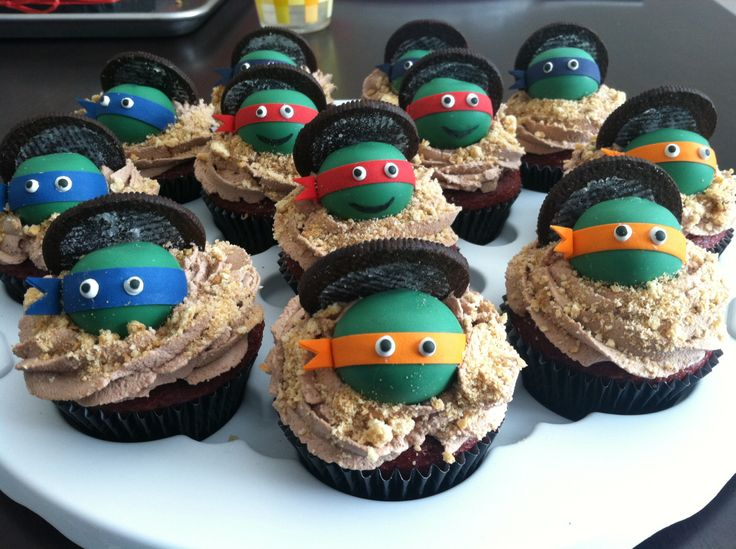 Teenage Mutant Ninja Turtle cupcakes with small cake pop balls as a topping