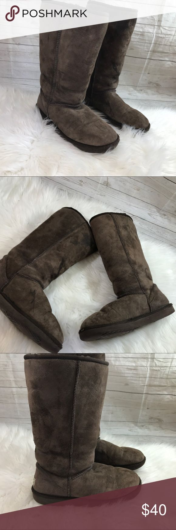 UGG Classic tall sheepskin boots brown Light wear on soles, pen mark on inside of left boot. Needs aftermarket insoles placed inside. Still can be worn without, the wool insoles were removed  Smoke free home  Size 8 UGG Shoes Winter & Rain Boots