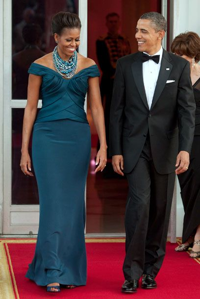 « The Michelle Obama Look Book 2012    29 of 76  March 14, 2012  Where: On the North Portico of the White House in Washington, DC, before the state dinner.  What: Dress by Marchesa; necklace by Tom Binns.     Photo: Joshua Roberts/Bloomberg via Getty Images    Email