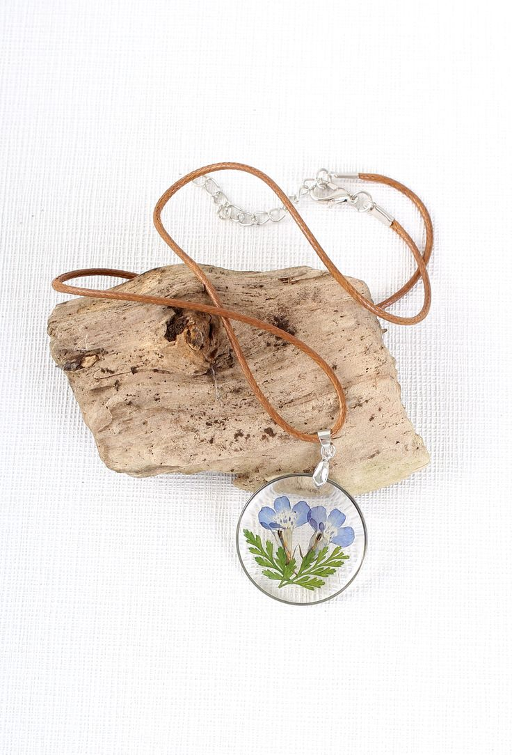 Miniature Botanist Necklace | Your new favourite necklace and the perfect accessory for all botanists and nature lovers!  A pretty blue and leaf enclosed in resin and set in a vintage style round bronze picture frame pendant.