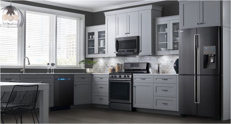 Black Stainless Appliances With Stainless Drawer Pulls And