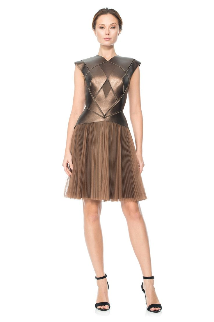 laser-cut bodice with pointy shoulders