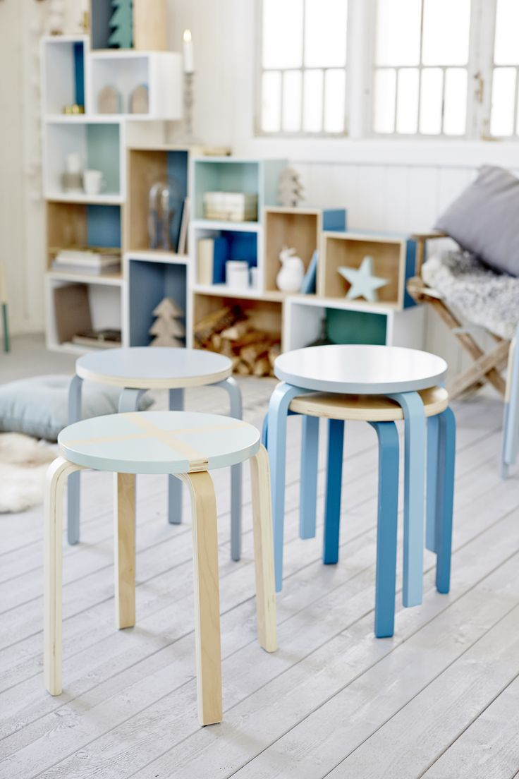 Painted IKEA stools in differens patterns and colours. See how we made these at http://www.anza.co.uk/tips-and-inspiration/articles/box-shelving
