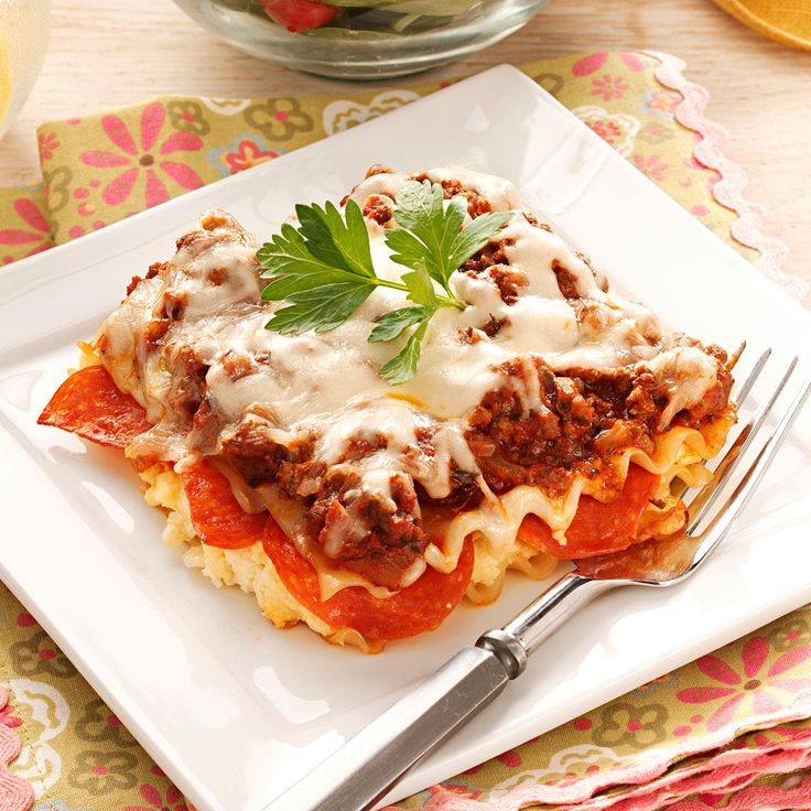 Pepperoni Lasagna Recipe -I've served this satisfying lasagna for years - when our children were small, they preferred it more than a steak dinner! Now my grandchildren request that I bring a pan along when I visit...and, of course, I do. -Barbara McIntosh, Midland, Texas
