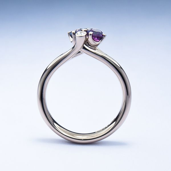 Spring Meadow ring in 18ct white gold with mauve sapphires and diamonds. The asymmetry of this design, coupled with the branching setting, gives it a wholly natural feel. #SpringMeadow #Fairtrade #Fairtradegold #Fairtradefortnight #unusualengagementring #JonDibben