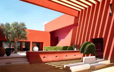Mexican holiday house—rich oranges and vibrant pinks.
