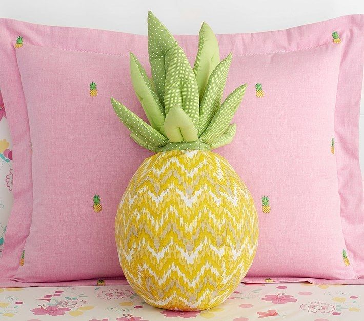 """A plush <a href=""""http://www.potterybarnkids.com/products/pineapple-shaped-decorative-pillow/?pkey=cdecorative-pillows-shams"""