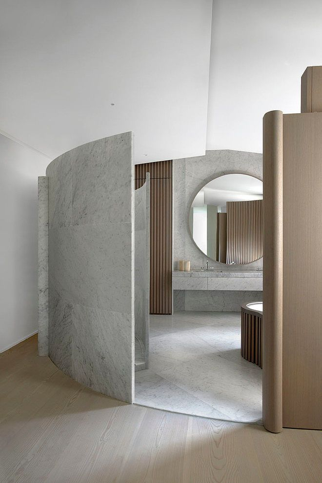 Inspiring Residence in Paris using curved walls and separations to create a room inside a room...x