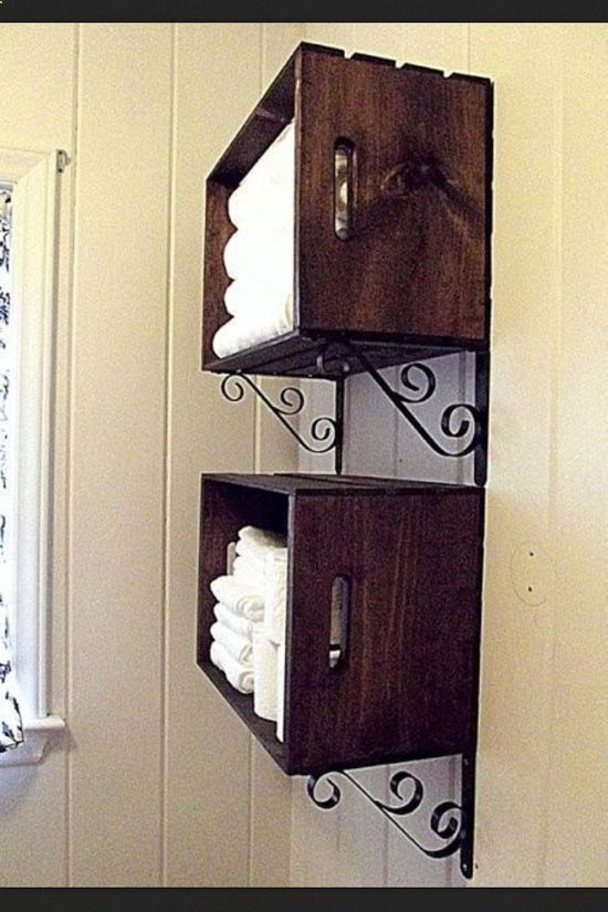 Pick up these crates at Michaels for about $14. Stain or paint. Add a pair of shelve brackets and you have an attractive storage unit for towels or anything else that requires easy access.