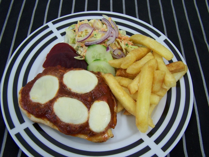 Chicken Breast topped with Tomato & Mozzarella Cheese served with Chips and Salad