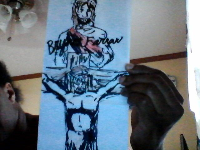 A picture of Christ on the cross drawn by Bryant Farrar on a paper bag.