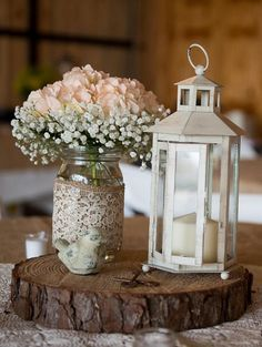 baby's breath and hydrangea in a mason jar / http://www.deerpearlflowers.com/cheap-mason-jar-wedding-ideas/2/
