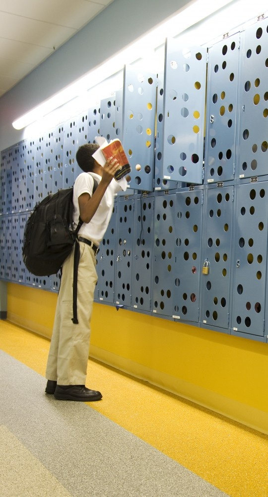 The East Harlem School / GLUCK+ Lockers with round holes
