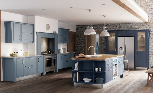 Denim blue kitchen cabinets  go perfectly with rustic brick walls and