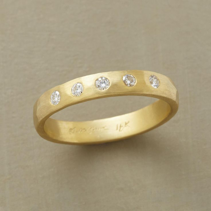 CARINA RING--Named for a constellation in the southern hemisphere,Sarah McGuire's 18kt gold diamond band ring twinkles with the star shine of five sparkling diamonds. To play up their splendor, she gives the hand-hammered ring a soft and subtle matte finish. Made in USA. Whole sizes 5 to 8.