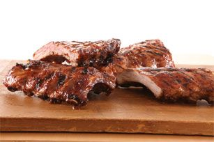 Saucy Foil-Pack Barbecue Ribs recipe - hint, be sure to dry rub ribs than bake ribs in heavy foil in oven at 300 for 2 hrs - than grill basted ribs for about 30 min