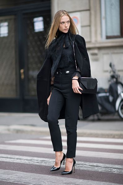 Hannah Ferguson is seen wearing Emanuel Ungaro coat Philosophy blouse Proenza Schouler pants Saint Laurent bag Schutz heels during Milan Fashion Week...