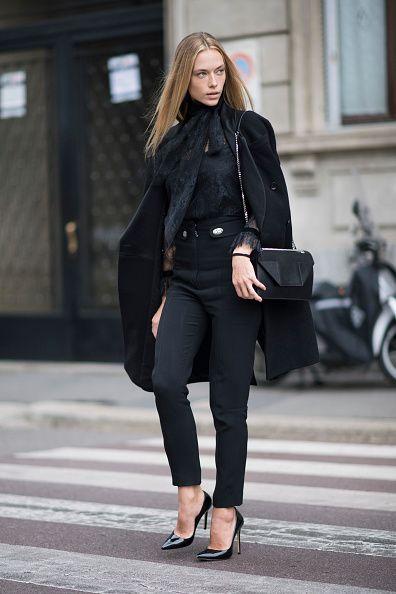 Hannah Ferguson is seen wearing Emanuel Ungaro coat Philosophy blouse Proenza Schouler pants Saint Laurent bag Schutz heels during Milan Fashion Week...