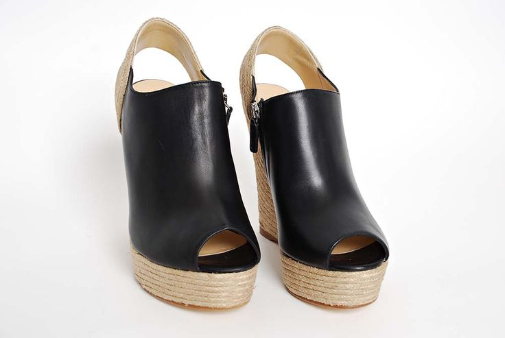 Black leather wedge sandals from Gucci