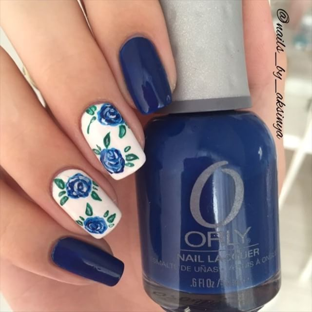 "Blue roses  I used: ✨@hm ""Whiteout"" ✨@orlynails ""Shockwave"" ✨@ceramicglaze Fast Drying Top Coat ✨Acrylic paint"