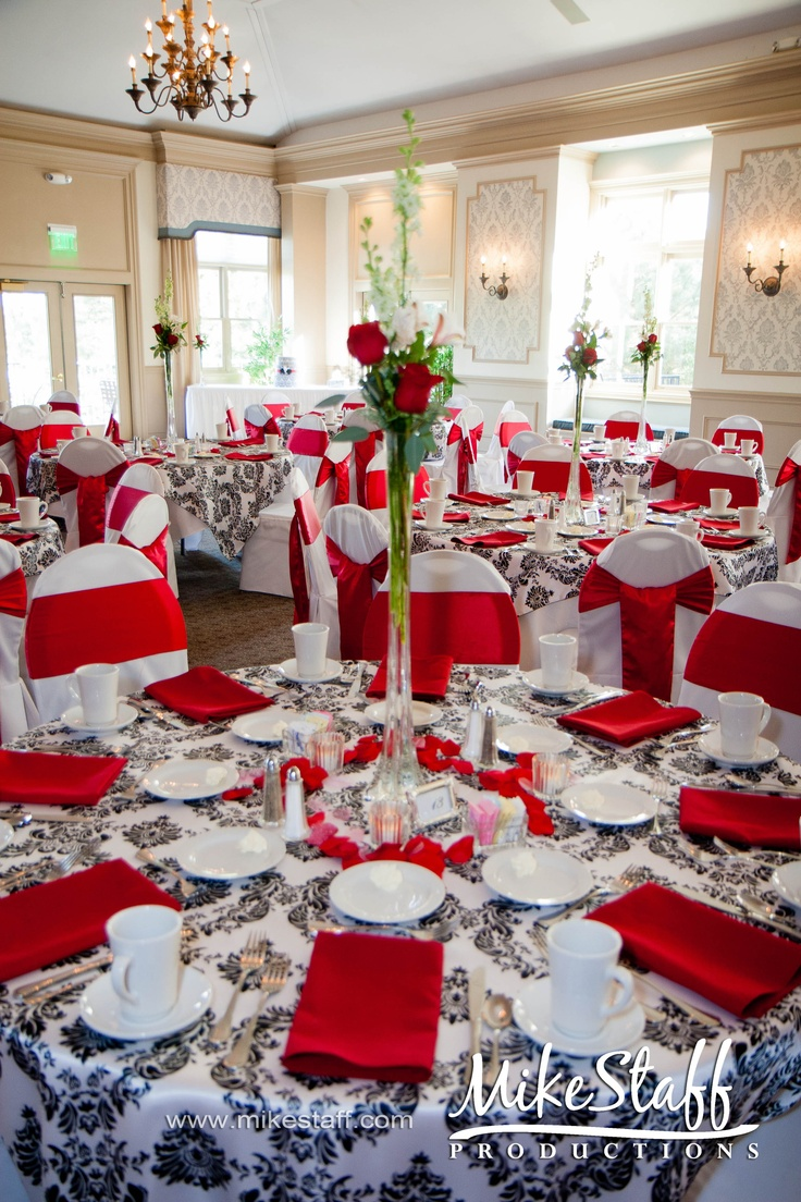 my table is similar to this, i would do a red table cloth and three large calla lilies as a centerpiece.. with tea lights and white rose petals.. we also have a red theme.