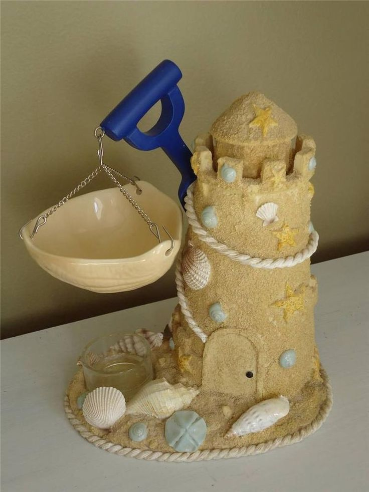 Item: RARE Sandcastle tea light tart warmer by Yankee Candle. Features: sandcastle , sand shovel, and seashells.
