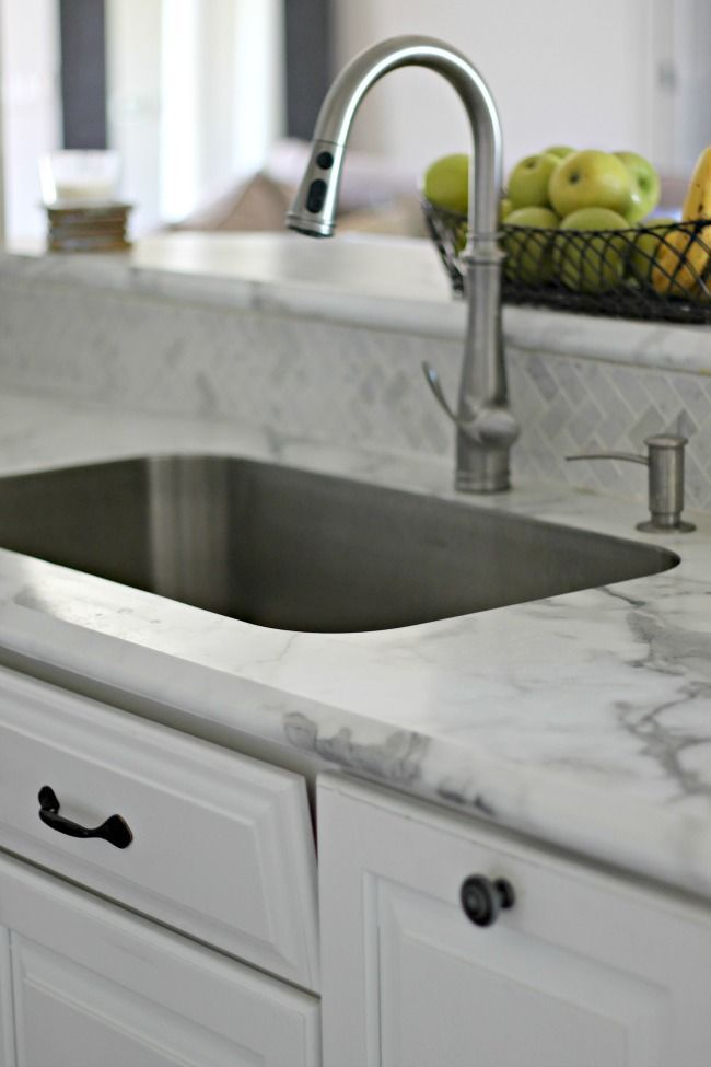 "Karran undermount sink can be used with formica countertops. New ""ideal edge"" formica countertops in Calcutta marble. Love the real marble backsplash."