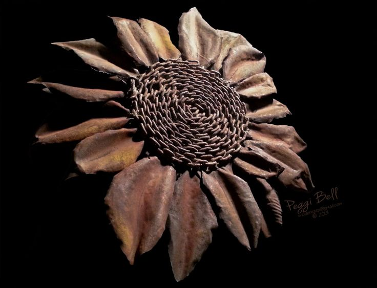 "Upcycled/recycled metal sunflower - 30"" - garden art - welded metal sculpture - materials include rusty chain, stove pipe, salvaged auto parts. Welded Art by Peggi Bell 