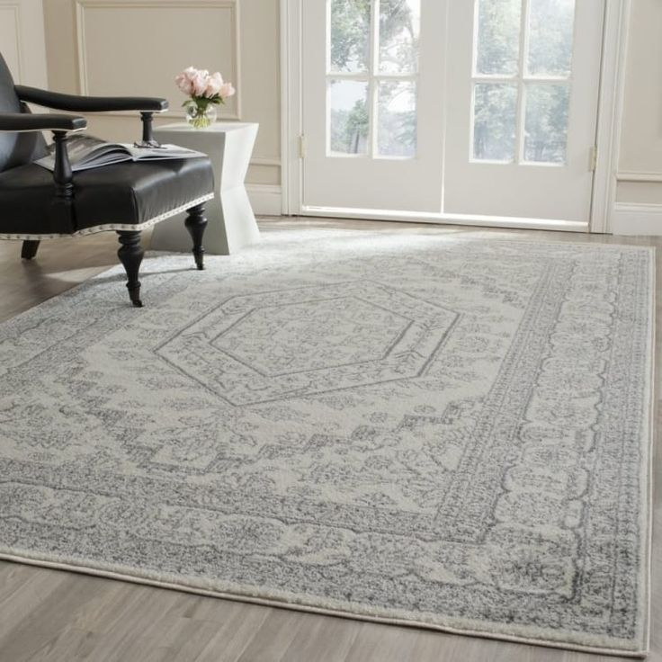 Promising review: 'I was in love as soon as I unrolled it. It's the perfect pattern without all the color that Oriental rugs usually have. Perfect for my neutral farmhouse style decor. It's not very plush so it will require a felt pad under it to thicken it up a bit but the quality, color, and pattern make this rug worth every penny!.' —Gabrielle CollierPrice: $24.98+ / Rating: 4.4/5 / Sizes: Available in 34 sizes. / Colors: Available in seven colors.