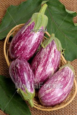 Striped Eggplants In A Basket Stock Photo