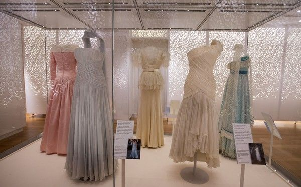 """Dresses made by desinger Catherine Walker in 1987 (2L), and Gina Fratini in 1990 (2R), worn by  worn by Britain's Diana, Princess of Wales in Hong Kong in 1989, are pictured during a press preview of the forthcoming exhibition entitled """"Diana: Her Fashion Story"""", at Kensington Palace in London on February 22, 2017..Glittering gowns, elegant suits and bold mini-dresses worn by the late Princess Diana will go on show from Friday on the 20th anniversary of her death in a unique exhibition…"""