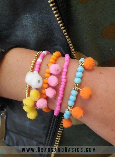 PomPom Ibiza Bracelets - pink, orange and blue pompoms - DIY + Materials to make your own at www.beadsandbasics.com