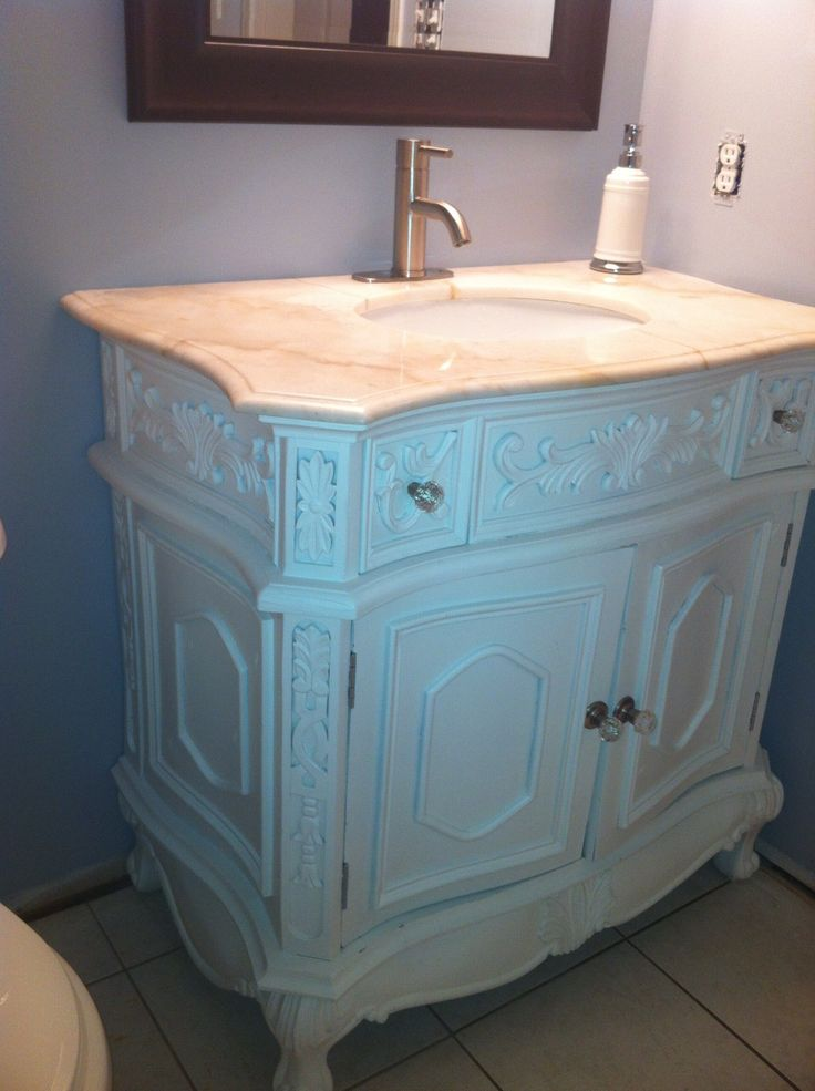 Refinished this vanity for my kids bathroom. Every time I walk past the room and see it, I love it even more!