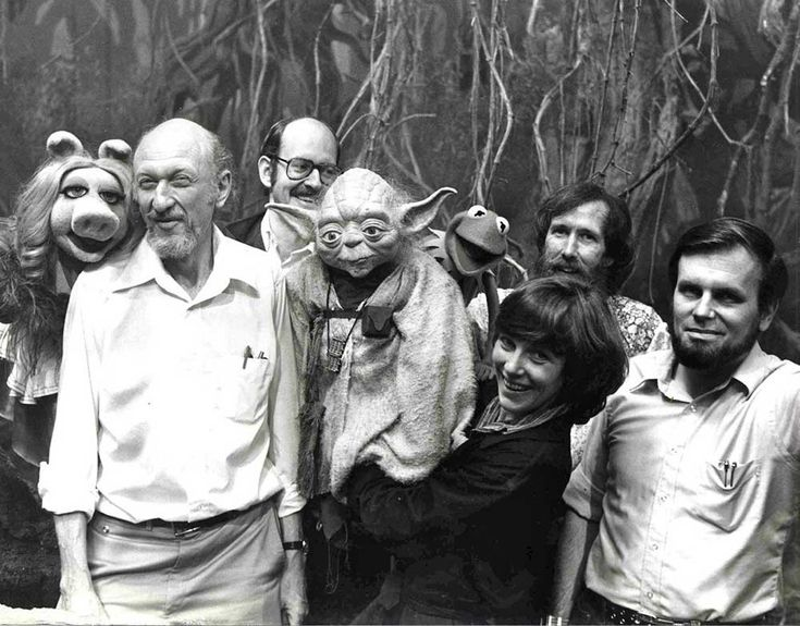 Irvin Kershner, Frank Oz, Jim Henson and Gary Kurtz with Miss Piggy, Yoda and Kermit on the set of The Empire Strikes Back.